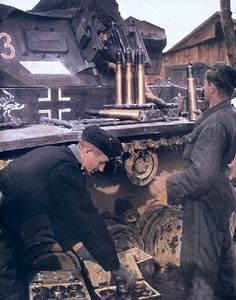 German tank crews, from the 15th Panzer Regiment of the 11th Panzer Division Wehrmacht loading shells in their tank PzKpfw III. Presumably the district of Moscow, winter 1941/1942 years.