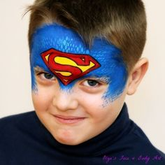 Fast and easy Superman face painting design that boys will love. Learn how to paint this bright mask with me. Easy face painting using stencils. Click on the image and watch the full tutorial on my YouTube Channel: International Face Painting School. #facepainttutorial #howtofacepaint