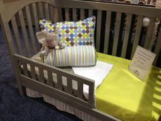 Green Toddler Blanket and circles on the pillow in a Baby's Dream convertible crib