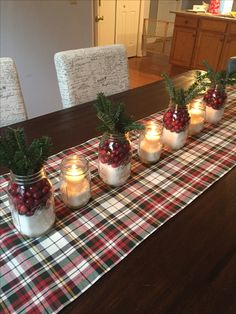 Christmas Table Decorations.  Cranberries, plaid and sugar.  Fresh greens from my tree. Pottery Barn runner