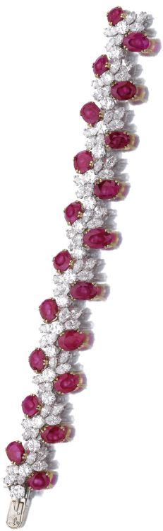 Ruby and diamond bracelet Designed as undulating line of brilliant-cut and marquise-shaped diamonds embellished with oval rubies, mounted in yellow gold and platinum, length approximately 165mm, numbered, French assay and maker's marks. Sotheby