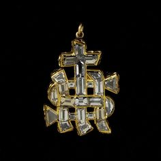 Pendant-Circa 1560  Excerpt: Diamond jewels were an intrinsic part of living nobly; they were a conspicuous emblem of wealth and were also believed by many to be endowed with magical powers. On this pendant, the diamonds have been arranged in the form of the monogram IHS.