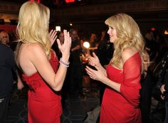 Christie Brinkley Photos Photos - Actress Rebecca Romijn and model Christie Brinkley prepare backstage at The Heart Truth's  Red Dress Collection 2012 Fashion Show at Hammerstein Ballroom on February 8, 2012 in New York City. - The Heart Truth's  Red Dress Collection 2012 Fashion Show - Backstage