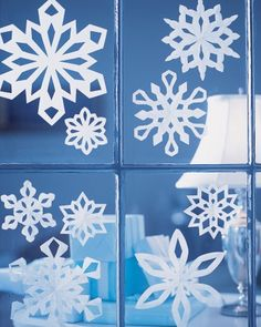 When moisture condenses and freezes on a window, some say that Jack Frost has stopped by, leaving the lacy pattern as a souvenir. Grace your panes with paper snowflakes, attaching them with poster putty. Or make a wreath of snowflakes by sticking them one at a time to a wall with poster putty. Kids can happily occupy themselves cutting out dozens of paper snowflakes. Then adults can step in with thread and tape, and together you can watch your family's own gentle blizzard materialize.