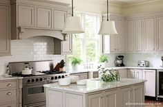neutral and beautiful kitchen with white subway tile and i think marble countertops