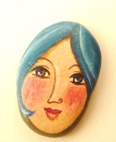 Painted stone. portrait on stone