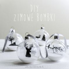 Go with dark paint on a clear ornament filled with snow.  Super fun looking.