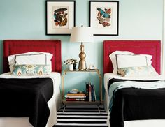 aqua, twin beds, graphic rug. Just might be the winning combo for the girls room!