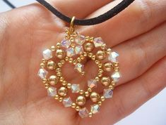 This tutorial includes details, easy step by step instructions with colour photos/pictures and materials list. The pendant is made using Swarovski bicone, pearl and seed beads, which are easily available. Time required approximately 1 hr 30 min Number of pages 13 Number of Steps 34 Skill