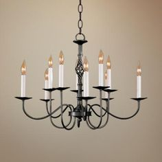 This Hubbardton Forge chandelier has a bold black finish, twisted font detail, and 10 candlestick style lights. Style # 20046 at Lamps Plus. Rectangle Chandelier, Candle Chandelier, Rustic Chandelier, Black Chandelier, Chandelier Shades, Chandelier Lighting, Chandeliers, Contemporary Chandelier, Classic Lighting