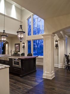 Adore the window and the open setting. The drop lights and sconces add elegance to the space.  #cultivateit