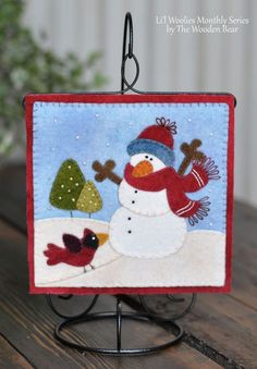 """Li'l Woolies January Snowman, by The Wooden Bear. Small hanging on a 7"""" ornament stand."""