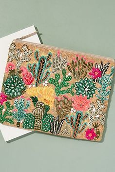 No holiday outfit is complete without holiday accessories like sunglasses, sun hats and more! Shop our carefully curated collection from Anthropologie. Hand Work Embroidery, Embroidery Bags, Hand Embroidery Designs, Beaded Embroidery, Beaded Clutch, Beaded Bags, Diy Bags Easy, Unique Purses, Boho Bags