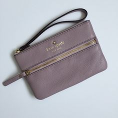 Kate Spade Cobble Hill Bee Cobble hill bee wristlet in great condition. Some wear on zipper and a small dot shaped stain inside. Color is hard to describe, kind of like a dusty rose, taupe, lavender mix. kate spade Bags Clutches & Wristlets