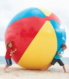 Taking beach ball fun to new heights! #giantgames #beachparty #summer