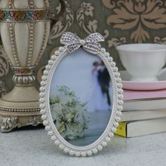 Oval Wedding Bow Photo Frame/4x6 inch This oval wedding bow photo frame is good for wedding photo. It catches the precious moment in your life and also makes your home look perfect.
