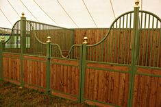 Wickliffe style stall shape with bar top; wood bottom; Euro-style center and bottom rails; and brass ball finials. Stalls by Lucas Equine Equipment.
