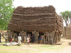 Africa |   Each Dogan village has its toguna, a house without walls but with 8 layers of millet straw.  The roof usually rather low, usually just high enough to feel comfortable when sitting.  This building is used by the village chief to resolve issues and it is said that the low roof  is intentional as it prevents individuals from getting over excited and making grand gestures.