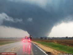 Northern Illinois Wedge Tornado! (natural+disasters thunderstorm tornado clouds rain hail Spring sky vehicles ). Photo by StormyPleasures, 4/'15.