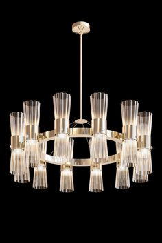 Style for any setting... this beautiful chandelier incorporates twelve softly pleated Murano glass cylinders. Each one has been lightly brushed with a translucent gold leaf powder generating a warm restful light. Modern Gold Leaf Murano Glass Chandelier. Merging unique artistry and imagination with functionality. Simply stunning!