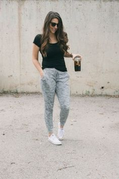 black tee and sweatpants