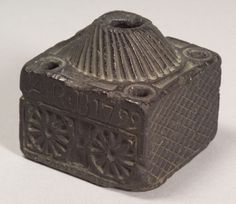 """Carved Soapstone Inkwell, probably America, dated 1799, square inkwell with carved swirled domed filler hole, and four dipping holes, three sides carved with geometric patterns, one side inscribed """"ARB 1799,"""" over two roundels, (wear), ht. 2 7/8 in."""