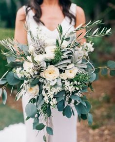 Modern #weddingbouquet idea - overflowing wedding bouquet with lots of greenery and cream peonies {Kendra Elise Photography}
