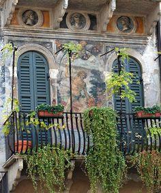 Balconies of Verona. Frescoes of the 16th century. Verona, Piazza delle Erbe Italy