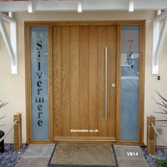 contemporary oak vertical boarded door and frame with sidelights