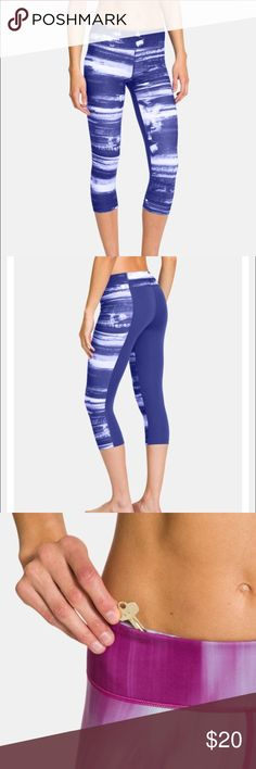 """UA Perfect Tight Fitted Capri PRODUCT DNA  * Fitted: Next-to-skin w/o the squeeze. * Signature super-soft, UA Perfect fabric has a matte finish * Wide, 2-piece waistband with a rise that sits just right on your hips * Anti-microbial """"strut gusset"""" construction fits just right and never looks too tight * Hidden waist pocket to stash your keys, cards, or cash * Allover print on front, blue on back * 20"""" inseam * Polyester/Elastane * Color: Siberian Iris * Come from a smoke free home and gently…"""