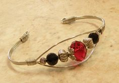 Wire Wrapped Cuff Bracelet / Black and Red / FREE SHIPPING. $18.00, via Etsy.