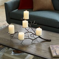 Graceful tree limb stretches realistic-looking branches of hand-wrought iron, studded with disks to support a flowering of pillar candles. Perfect for creating a warm, rustic and classic fall table. Lantern Candle Holders, Candle Stand, Cheap Candle Holders, Wrought Iron Candle Holders, Candle Holder Decor, Fall Table, Metal Furniture, Crate And Barrel, Pillar Candles