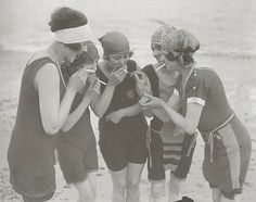 Women smoking on New York public beach. The sight of a woman enjoying a good cigarette flew in the face of proper etiquette, thus becoming a handy display of rebellion in a age when women were fighting for other rights, most notably the right to vote.