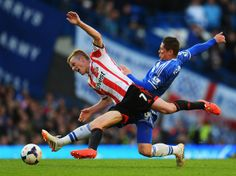 Sebastian Larsson of Sunderland is tackled by Fernando Torres of Chelsea during the Barclays Premier League match between Chelsea and Sunderland at Stamford Bridge on April 19, 2014 in London, England. (April 18, 2014 - Source: Mike Hewitt/Getty Images Europe)