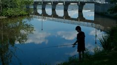 Silhouette of boy fishing on the Mille-îsles River Boy Fishing, Small Island, Milling, Track, Silhouette, River, History, Historia, Runway