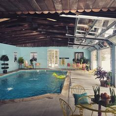 Love the idea of using garage doors in a pool house