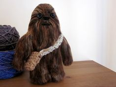 a crocheted wookiee! Isn't this the best? So far it's my favorite Star Wars craft but I haven't really investigated them that much.