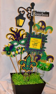 Mardi Gras Centerpiece  Let the party begin with this festive centerpiece celebrating Mardi Gras! Each stick is cut with card stock and
