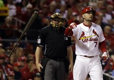 St. Louis Cardinals' Matt Holliday tosses his bat after striking out during the first inning of Game 5 of baseball's World Series against the Boston Red Sox Monday, Oct. 28, 2013, in St. Louis. (AP Photo/Jeff Roberson)