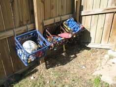 Outdoor toy storage to keep yard picked up. Water and dirt fall right through the holes. I need to do this ASAP! Do you need outdoor toy organization tips and ideas for all of those outdoor toys? I've found some great solutions to help you. Outdoor Toy Storage, Outside Storage, Diy Toy Storage, Storage Hacks, Milk Crate Storage Ideas, Storage Crates, Backyard Storage, Toy Diy, Cheap Storage