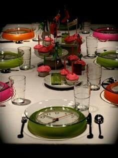 New years eve table setting.... clear, glass plates with dollar store clocks :)
