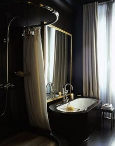 Too dark to be functional, but I love the richness of the black and that mirror over the bathtub is phenomenal.