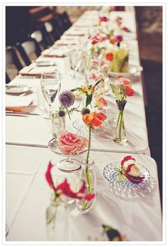 Great way to make things interesting, highlight beautiful blooms and beautiful glassware.