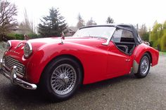 This 1959 Triumph TR3A received a body-off restoration performed by its previous owner in 2014. The car is fitted with wire wheels, an unrestored hardtop, rare rear seat, heater, and a factory 4-speed with overdrive. The top, tonneau cover, and interior are all new. This is a sharp TR3 that is ready