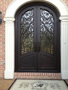 Tuscany Design - front door. I love this front door. Couldn't do a curved one at my house, but it'd still be cool even without the curve.