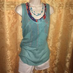 Maurice's crochet sleeveless top Perfect condition! Never worn. Looks great with a solid or multi colored tank (as shown). Maurices Tops Tank Tops