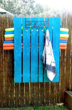 Reuse a pallet this summer to organize your pool noodles and use as a towel rack! Our Logistics Coordinator, Kat, made this one!