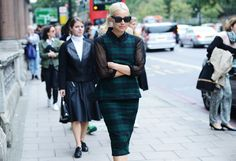green/blue plaid print skirt and matching top with sheer black sleeves (photo by Tommy Ton) Tommy Ton, Milan Fashion Week Street Style, London Fashion, Tartan Fashion, Fashion Corner, Slide, Tartan Plaid, Blue Plaid, Plaid Suit