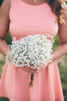 Simple baby's breath bouquet for rustic wedding bridesmaid. #bouquet #babysbreath #weddingchicks Floral Design: The Flowerman --- http://www.weddingchicks.com/2014/04/29/a-wedding-cake-dilemma/