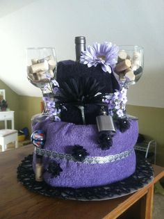 Towel Cake, one bath towel, one hand towel, one wash clother. Ribbon, flowers, wine, glasses and some crafting and other little touches for a wedding shower